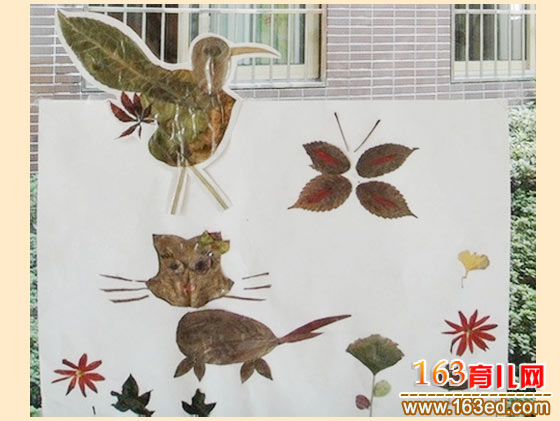 小猫戏蝶 树叶粘贴画